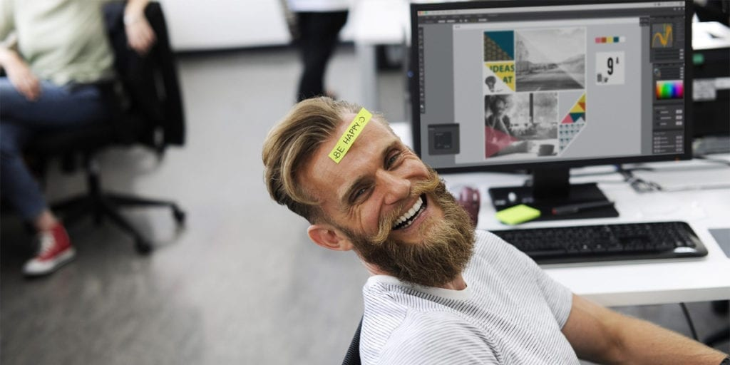 hipster man with post it on forehead